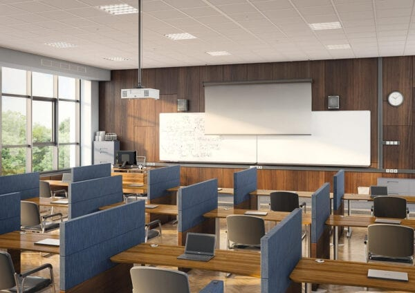 privacy panels seperating desks in a college classroom